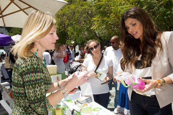 Ali Landry, actress, model and mother of two, checking out a Born Free cup at Pregnancy Awareness Month in LA (May 6, 2012). Photo/Born Free, Susan Goldman.